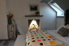 Bedroom conversion with modern fireplace