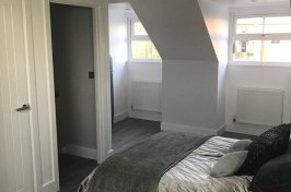 Bedroom conversion with bed and laminate flooring