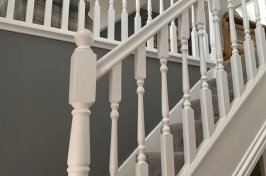 Side view of wooden staircase painted white