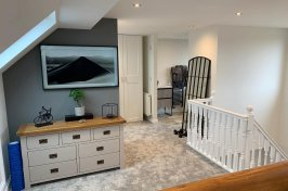 Functional loft conversion with photo on the wall and furniture