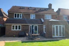 Garden view of detached house with loft conversion