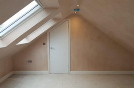 Empty plastered loft conversion ready for painting