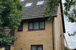 Property with new velux loft conversion and full skip