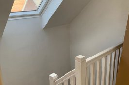White painted wooden stairs in loft conversion