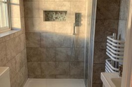 Walk in shower with shelf