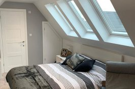After photo of velux loft conversion used as bedroom