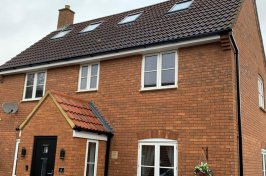 Outdoor view of detached house with velux roof conversion