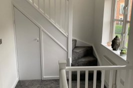 Wooden staircase painted white
