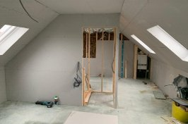 Loft office conversion with plasterboard and stud wall
