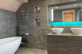 Bathroom conversion with towel radiator and built in storage units