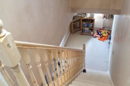 Wooden staircase and hallway plastered